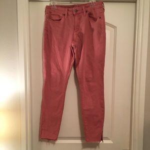 Salmon skinny jeans